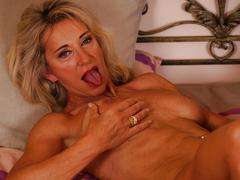 Big titted blonde mature josefine fingers her holes