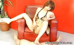 Shaved nippon milf dominates with her feet