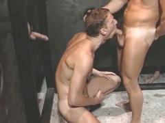 Hunky dad kneels for glory hole suck