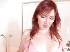 Redhead babe ellinude in tiny pink bikini