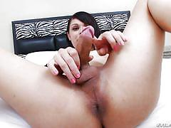 Pretty tranny babe doing a seductive solo jerking