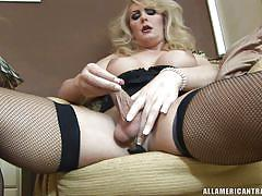 Busty tranny jerking cock and fingering ass