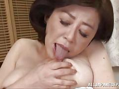 Mature japanese lady fingering her pussy