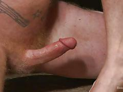 Gay slave cums on master's feet and licks it
