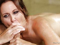 Super hot brunette masseur pleasing a client
