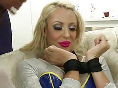 Blonde milf is tied up and face fucked by tranny cock