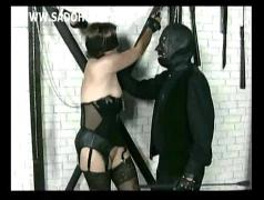 Master ties old horny slave with large pussy to a wall and spanks her on the ass