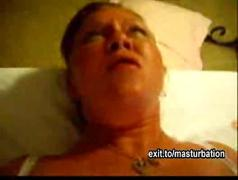Red haired mother cums with dildo