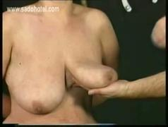 Horny older slave with hangin tits got wooden clamps and candle wax on her big boobs by her master
