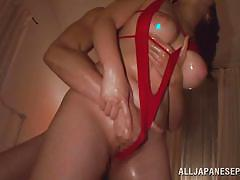 Asian beauty playing dirty in bed