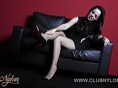 Brunette tease wearing nylon pantyhose