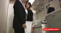 Hot office lady masturbating while standing in the...