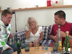 Two young horny studs screw a drunk blonde mature