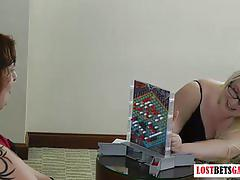 Two bigger girls play strip games.