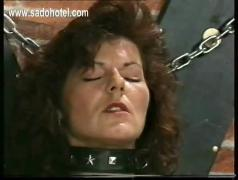 Master puts metal clamps on pussy lips and nipples of two horny slaves tied to wall