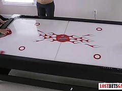 Three cute babes play strip air hockey