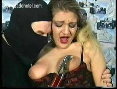 Crying slave is hit with a whip on her shaved pussy and got her nipples twisted with a piers