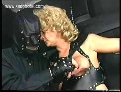 Old slave with big tits tied in a dungeon got metal clamps on her large nipples