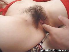 Fucking her hairy pussy with toys
