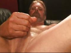 Hairy daddy ray strokes cock on couch