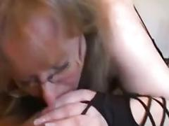 Mature busty amateur takes care of husband's shaved cock