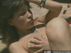Lewd asian chick dildoing wet pussy