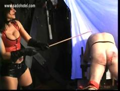 Hot mistress with big tits spanks bend over dirty slave on his untill he bleeds