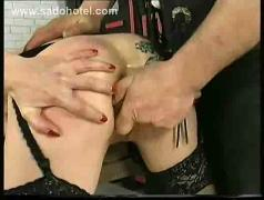 Horny slave is spanked on her tiny tits and ass and master fucks her with his hands and dildo
