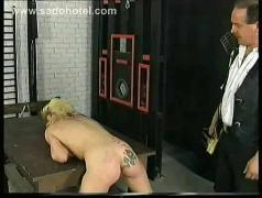 Blond slave undresses and bends over so her master can spank her and cover her ass