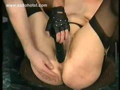 Masked master spanks milf slave on her ass her fuck her with a dildo in his dungeon