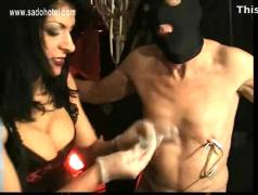 Masked slave gets large meat hooks through his nipples and got them electro shocked