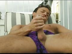 Big dick hunk jerks his big cock beside the pool