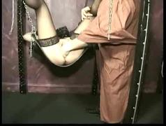 Master plays with clit of horny tied slave and fucks her with his hands until she cums