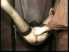Slave wearing leather and her arms tied got her pussy mastrubate and played
