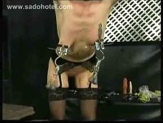 Germans slave get pulled on her nipples and spanked on her ass and also gets metal clamps on her tit
