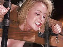She couldn't scream, as wooden clothespins are attached to her tongue