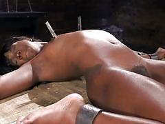 Sexy ebony gets tortured while in hard metal bondage