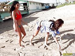 Hot lesbians are having fun on the sea shore