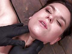 Swollen nipples clutched between two wooden sticks