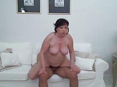 Buxom mature woman enjoying an orgasm