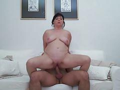 Buxom mature woman enjoying an orgasm