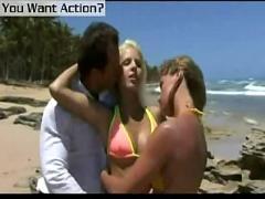 Three-way beach sex