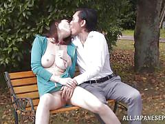 Kinky action on a bench in the park
