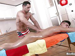 Oiled up and dildo fucked by his masseur