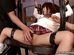 Asian schoolgirl has her squirting bush toyed with