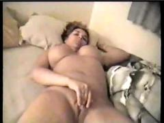 Big titted girl rubbing her pussy