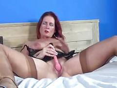 Mature milf in stockings and stripper heels fucks herself