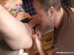 Curly babe fucked in the kitchen
