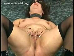 Older slave lying on the floor plays with her tight pussy and tits until she cums screaming