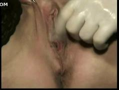 Master hits tied slave with a whip on her tits and fucks her pierced pussy with his hands